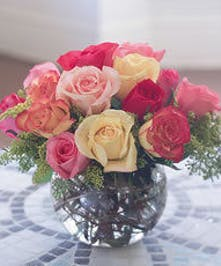 Dive into this bubble bowl design of beautiful mixed color roses!