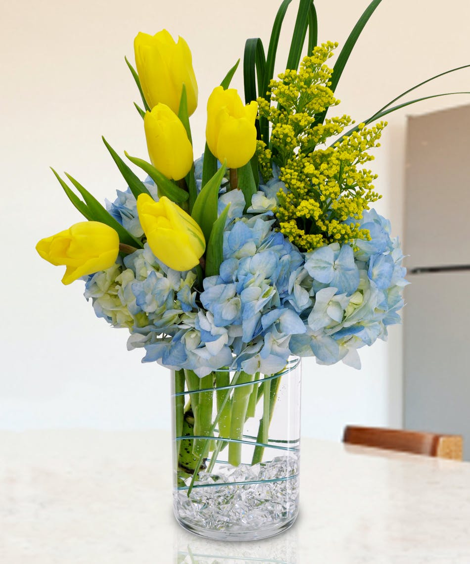 Celebrate Spring with this beautiful arrangement of tulips and hydrangea.