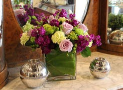 A lovely arrangement of purple, pink, green and white flowers